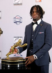 Alabama's Jerry Jeudy poses with the trophy after winning the Fred Biletnikoff Award for outstanding receiver in college football, Thursday, Dec. 6, 2018, in Atlanta. (AP Photo/John Bazemore)