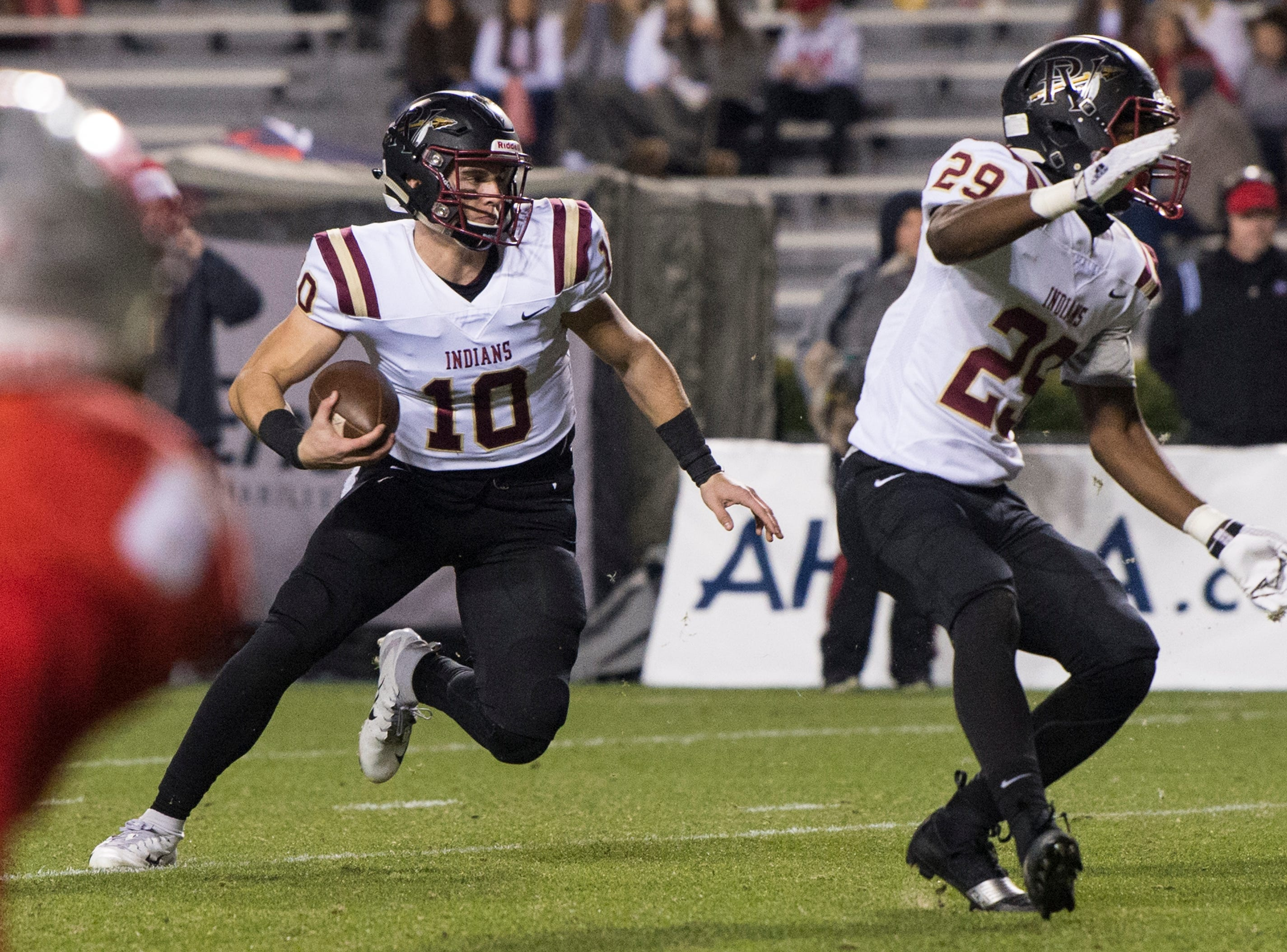 Pinson Valley's Bo Nix (10) runs the ball against Saraland during the Class 6A state championship at Jordan-Hare Stadium in Auburn, Ala., on Friday, Dec. 7, 2018. Pinson Valley leads Saraland 12-3 at halftime.