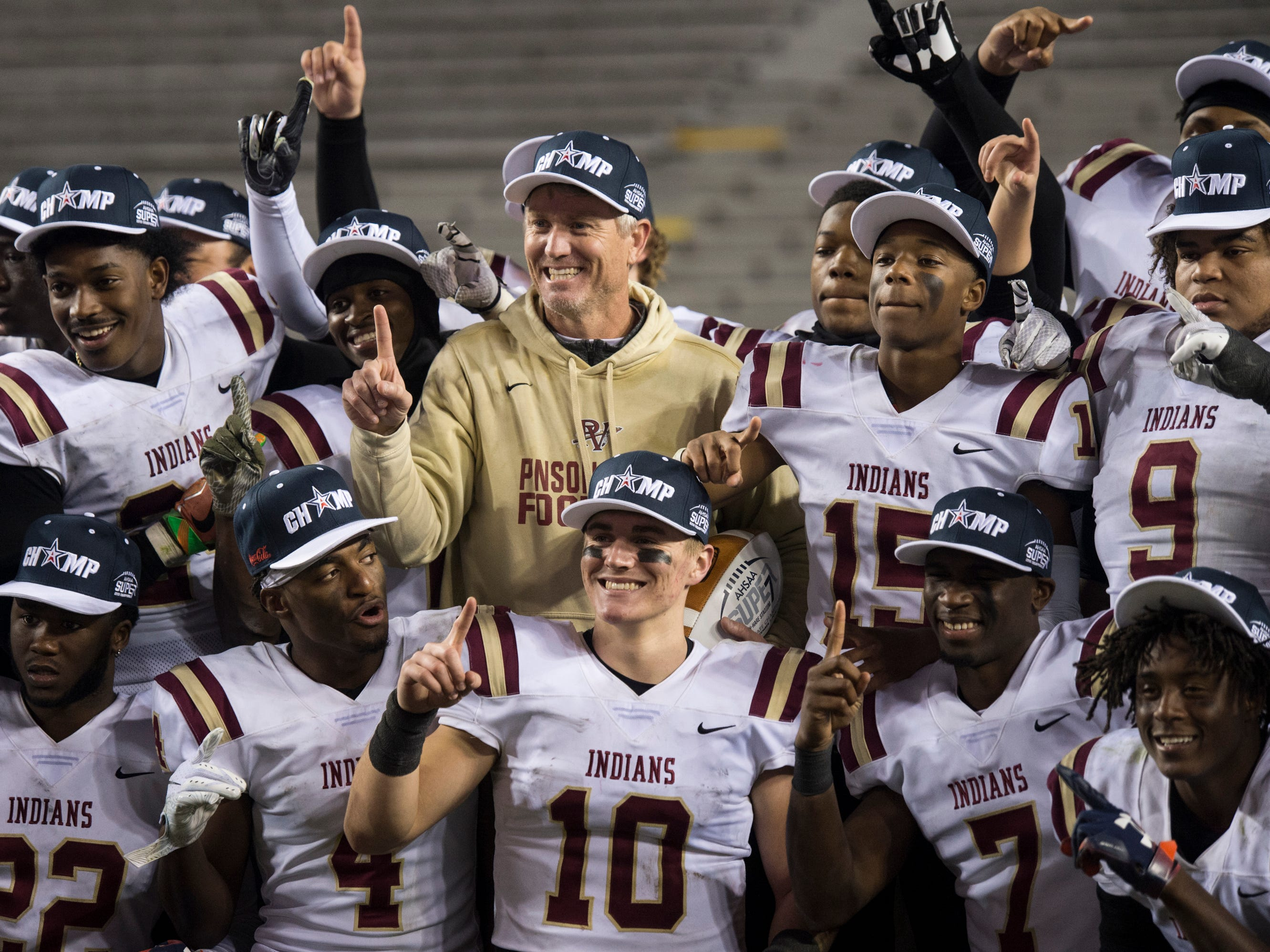 Pinson Valley coach Patrick Nix poses for a picture with his team during the Class 6A state championship at Jordan-Hare Stadium in Auburn, Ala., on Friday, Dec. 7, 2018. Pinson Valley defeated Saraland 26-17.