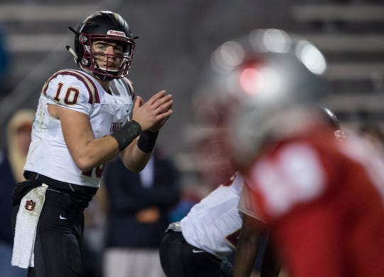 Pinson Valley's Bo Nix (10) reads the defense before snapping the ball during the Class 6A state championship at Jordan-Hare Stadium in Auburn, Ala., on Friday, Dec. 7, 2018. Pinson Valley defeated Saraland 26-17.