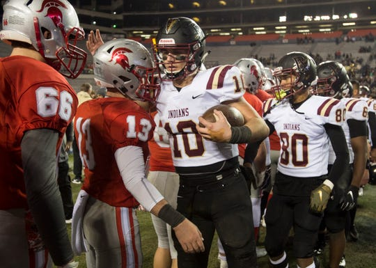Pinson Valley's Bo Nix (10) hugs Saraland players after the Class 6A state championship at Jordan-Hare Stadium in Auburn, Ala., on Friday, Dec. 7, 2018. Pinson Valley defeated Saraland 26-17.