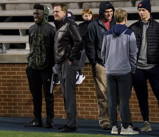 Auburn head coach Gus Malzahn talks to running back recruit Mark-Antony  Richards (far left) during the Class 6A state championship game at Jordan-Hare Stadium in Auburn, Ala., on Friday, Dec. 7, 2018. Pinson Valley defeated Saraland 26-17.