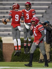 Luverne's Tae Brantley (9) and Ra Ja Moneyham (3) celebrate after Brantley's touchdown during the Class 2A state championship at Jordan-Hare Stadium in Auburn, Ala., on Friday, Dec. 7, 2018. Fyffe defeated Luverne 21-19.