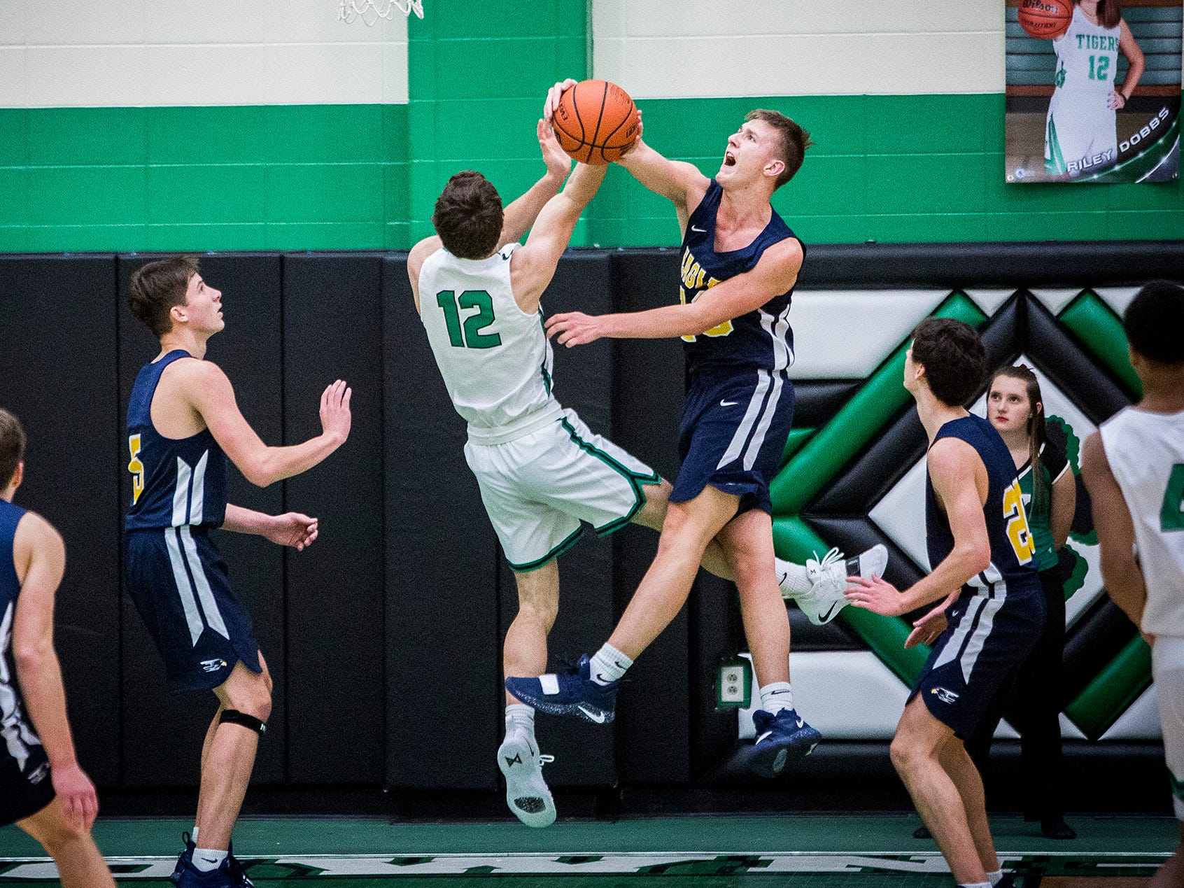 Delta's Tyler Wilburn denies a shot from Yorktown during their game at Yorktown High School Saturday, Dec. 7, 2018.