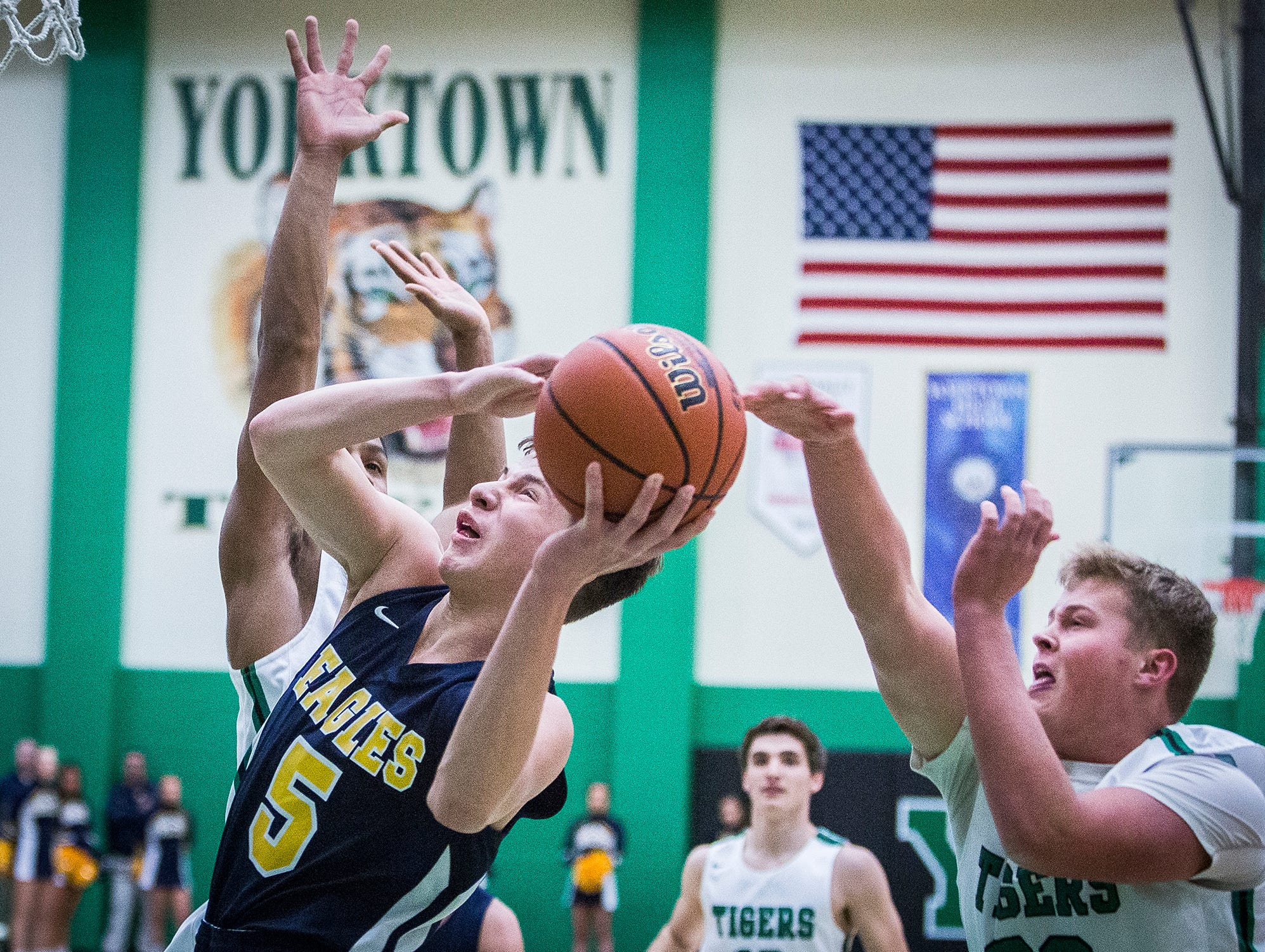 Delta's Josh Bryan looks to shoot past Yorktown's defense during their game at Yorktown High School Saturday, Dec. 7, 2018.