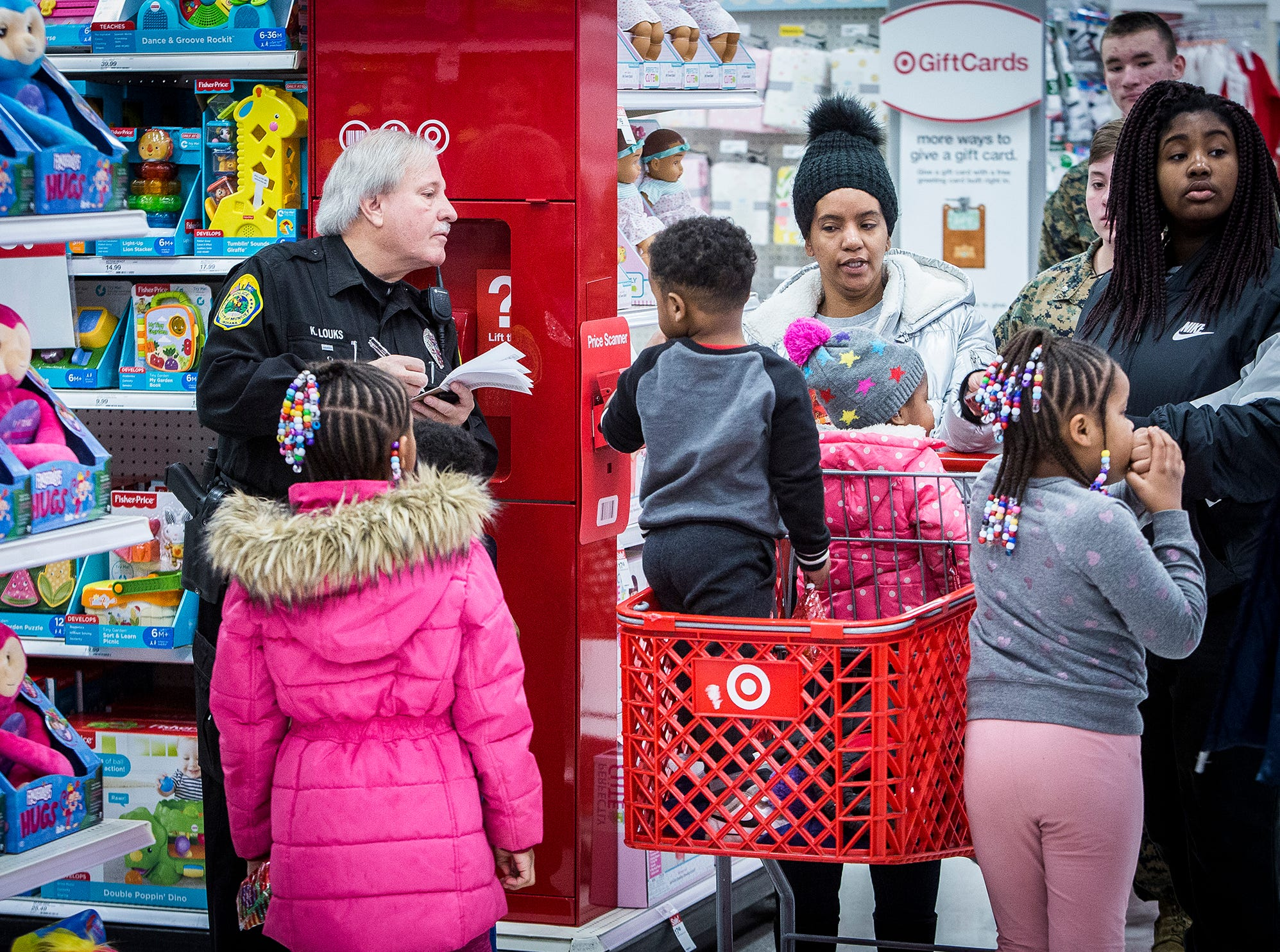 Firefighters, police officers and members of the JROTC volunteered to help families shop for Christmas gifts at Target during the annual Heroes and Helpers event Saturday morning.  The Fraternal Order of Police Lodge 87 sponsored the event which served around 150 children this year.