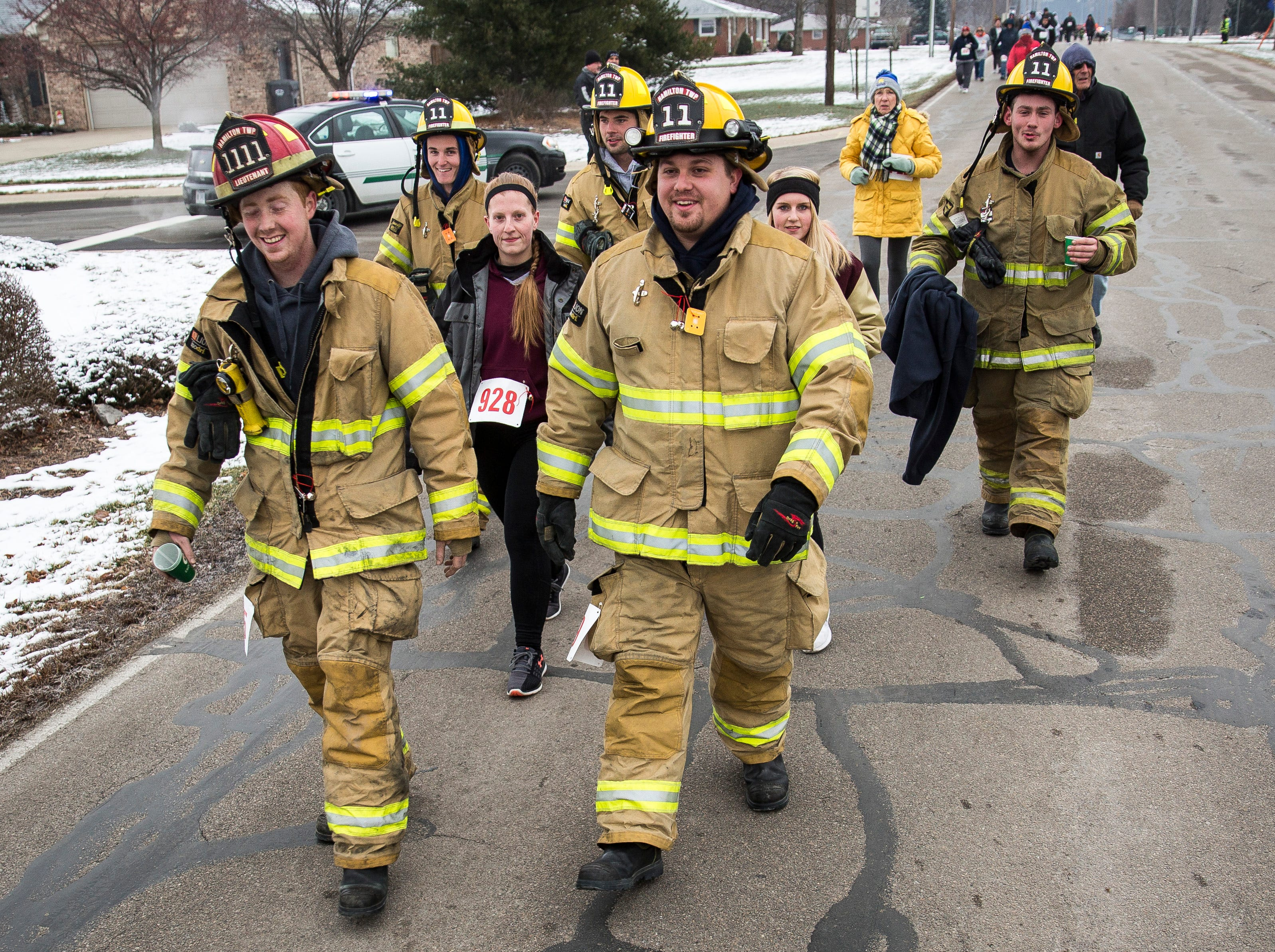 Runners take to the streets in the cold for the Yorktown Volunteer Firefighter's Association third annual Fire and Ice Holiday 5K run and walk on Saturday in downtown Yorktown.