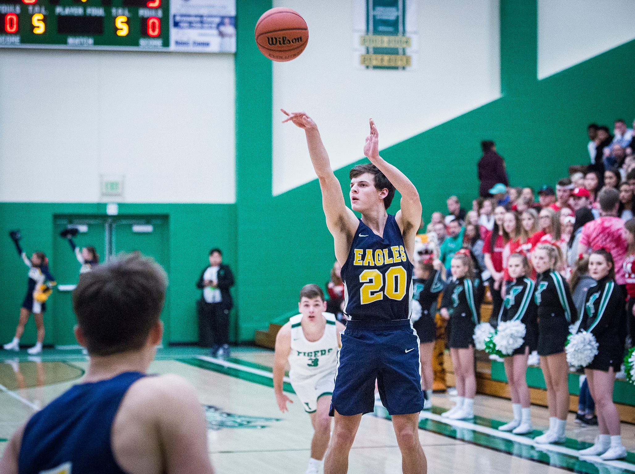Delta's Josh Greenberg shoots a three pointer against Yorktown's defense during their game at Yorktown High School Saturday, Dec. 7, 2018.
