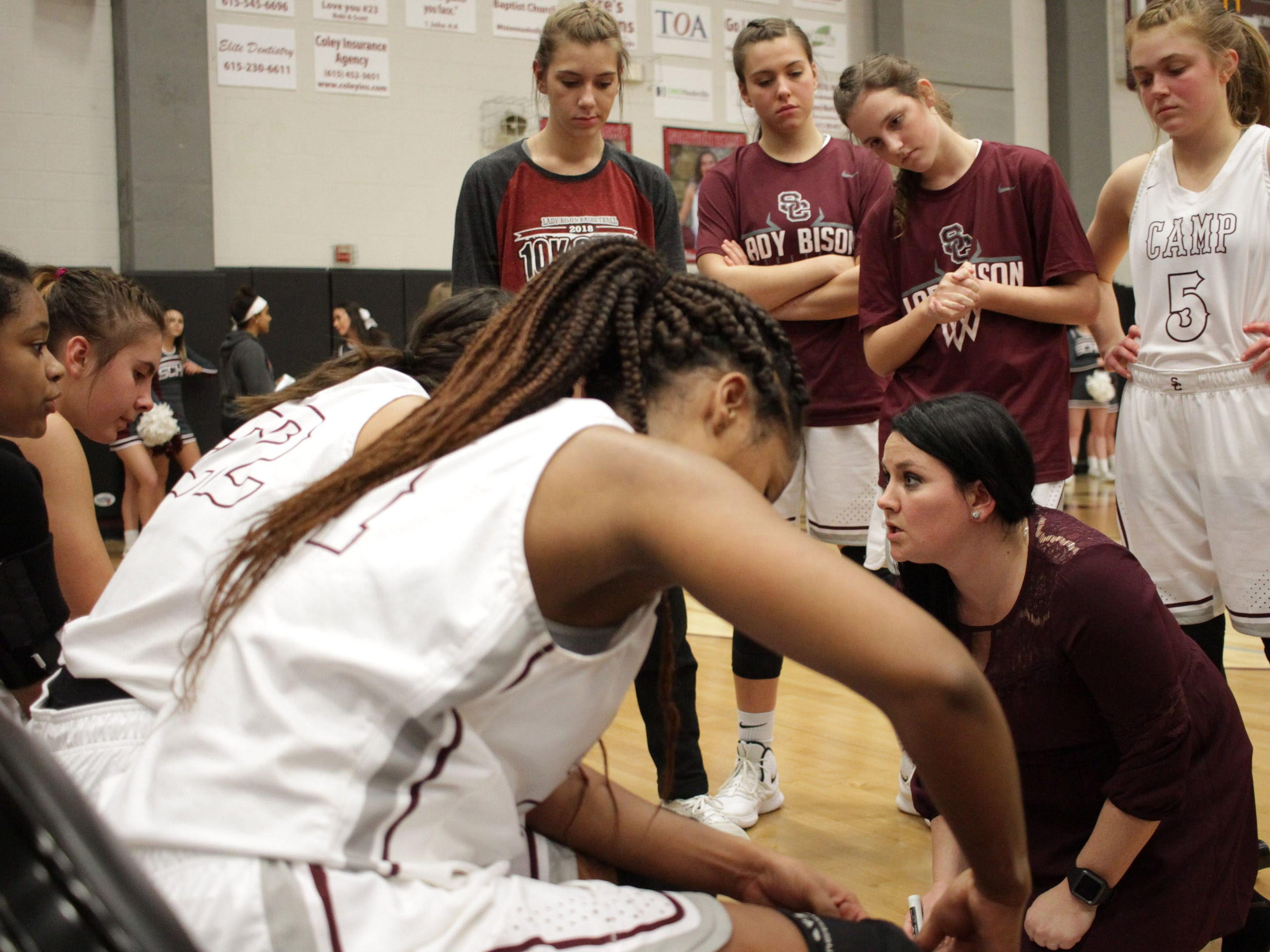 Station Camp coach Miranda Cravens goes over a play with her team as they play Beech on Friday, December 7, 2018.