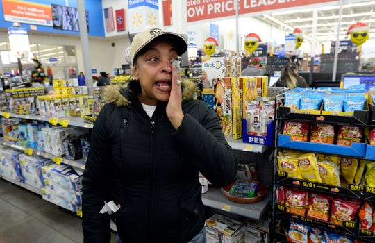 Kenya Sanders wipes tears away as she heads to pick up the Christmas gifts she had on layaway at a Walmart store on Saturday, Dec. 8, 2018, in Nashville, Tenn. Kid Rock spent about $81,000 Saturday to pay off the balances of 350 layaway accounts, including the one belonging to Sanders, at the Dickerson Pike store.