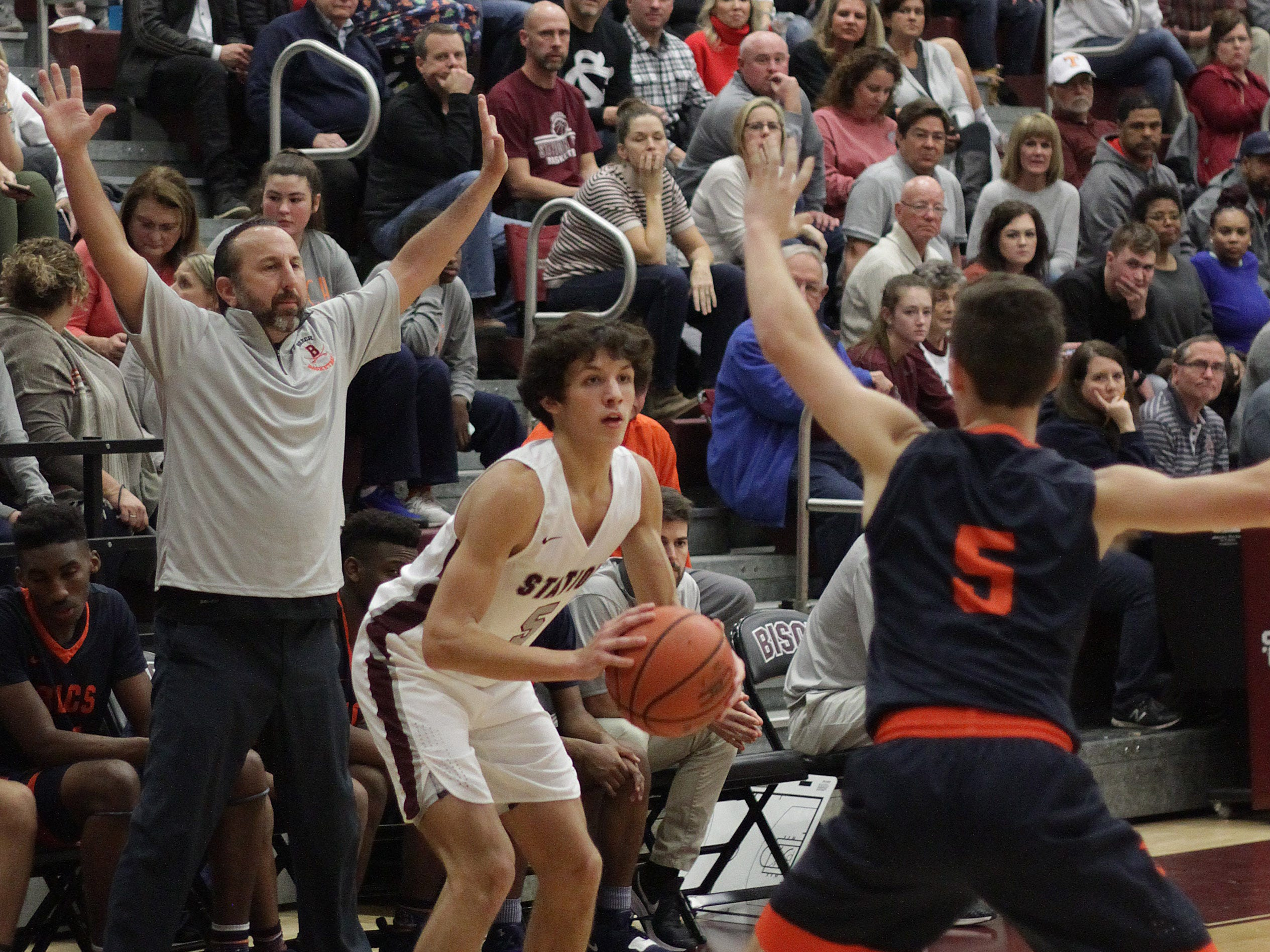 Station Camp's Dane Diez looks to shoot while guarded by Beech's Luke Fleming on Friday, December 7, 2018.