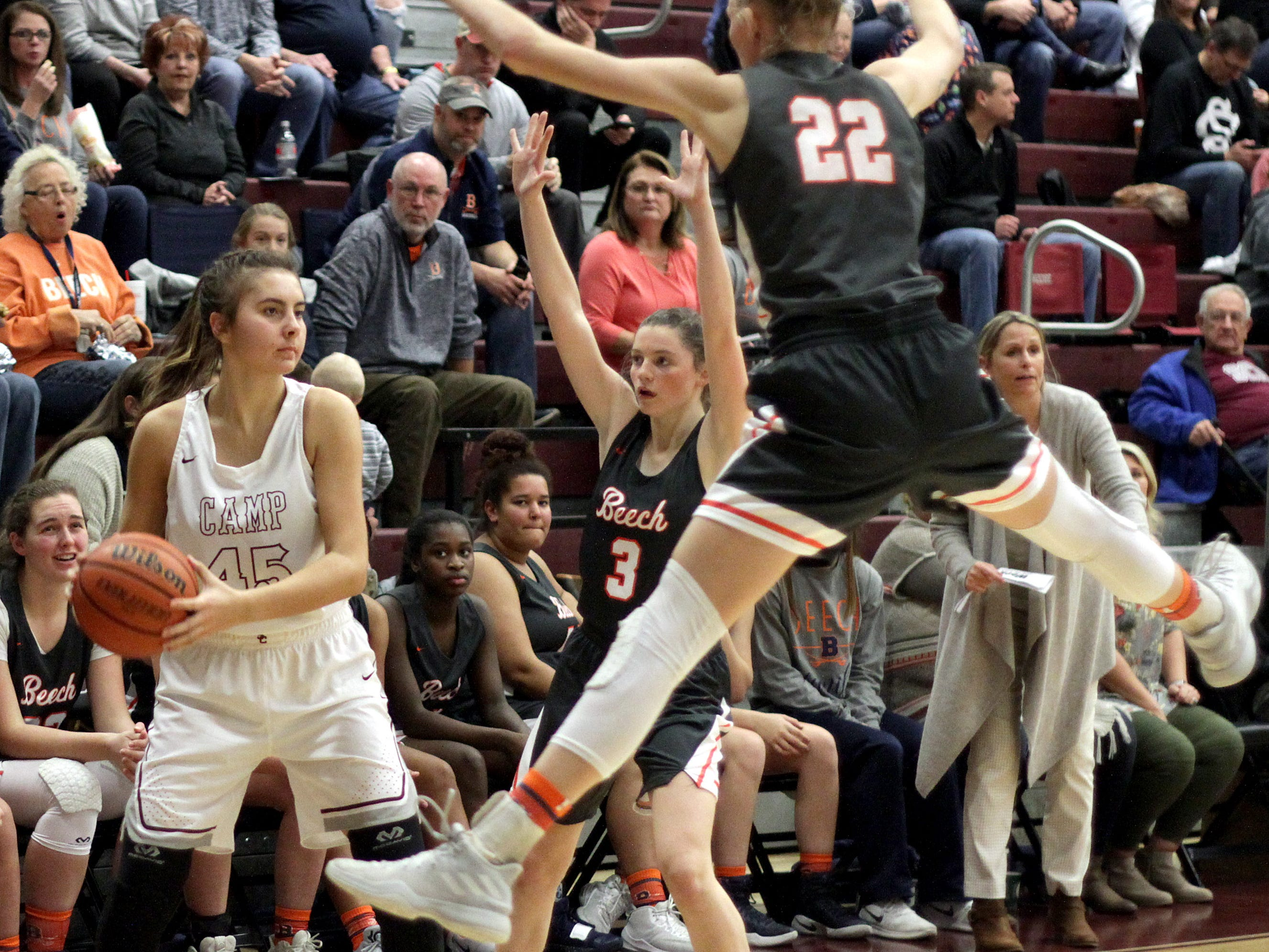 Station Camp's Olivia Delk looks to inbound the ball as Beech's Kenda Muellar and Jana Claie Swafford guard on Friday, December 7, 2018.