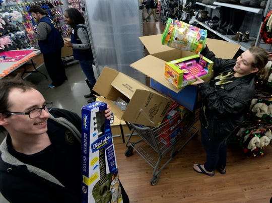 Autumn and Woody Nuncio show the Christmas gifts they had on layaway at a Walmart store on Saturday, Dec. 8, 2018, in Nashville, Tenn. Kid Rock spent about $81,000 Saturday to pay off the balances of 350 layaway accounts, including the one belonging to the Nuncios, at the Dickerson Pike store.