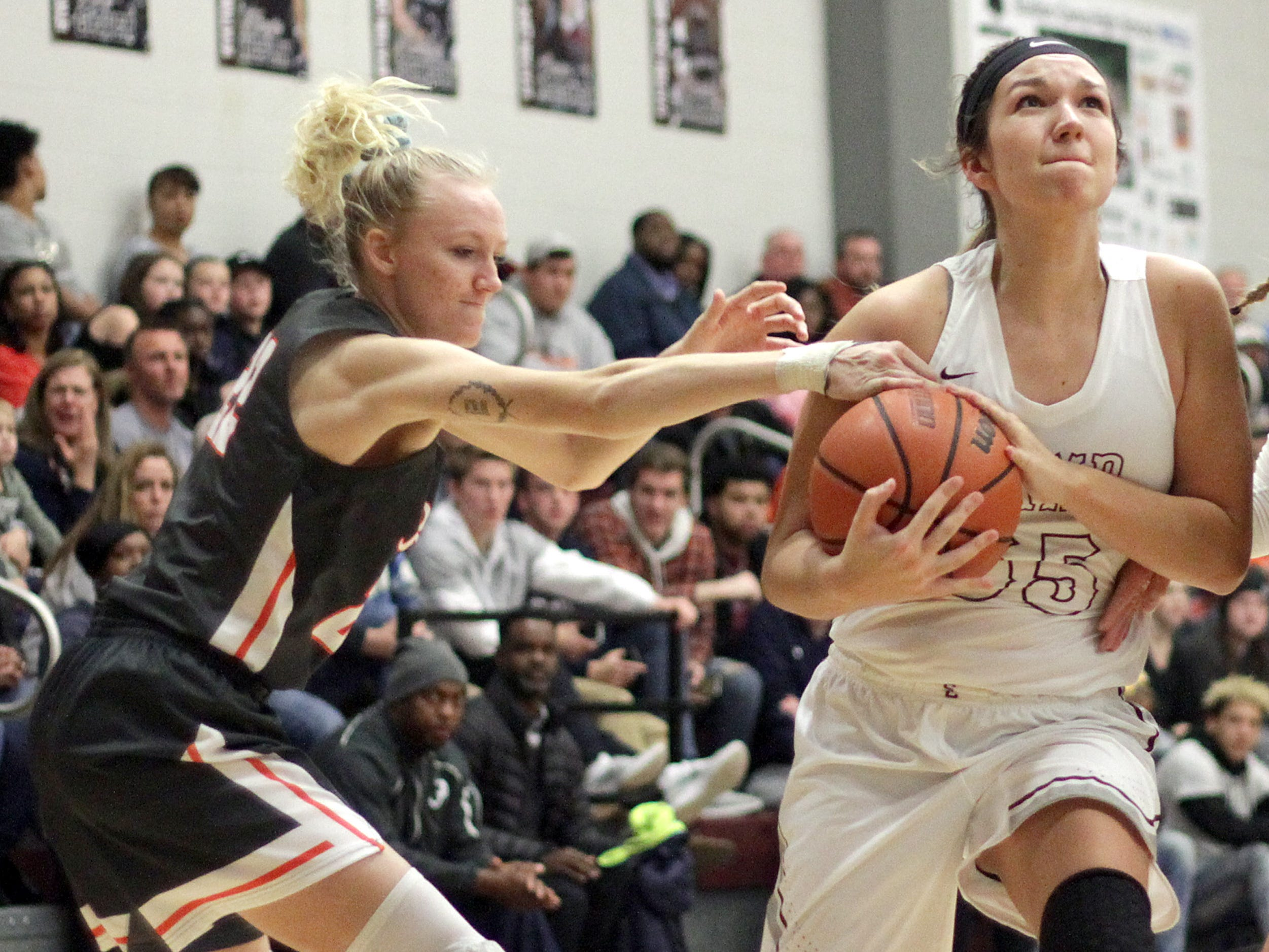 L-R Beech Kendra Mueller reaches in and fouls Station Camp's Faith Eubank on Friday, December 7, 2018.