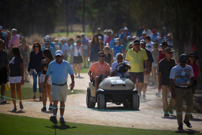 Spectators along walks to get to the tee box during the 30th annual QBE Shootout Pro round two on Saturday, Dec. 8, 2018, at Tiburon Golf Club in Naples. This year's tournament will not have any fans due to the coronavirus pandemic, and that has had a domino effect on parts of the event.