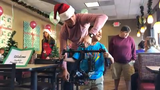 """Maria's Birthday Wishes for the Homeless hosted a holiday event called """"Breakfast With Santa"""" that provided food and Christmas gifts to those in need."""