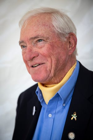 """Brendan Cunningham, 73, has been the the tee announcer for the QBE Shootout every time it has been hosted in Naples. Cunningham recently had an emergency tracheotomy and the scarf hides the opening in his neck. """"I shouldn't even be here,"""" Cunningham said """"But I'm blessed."""""""