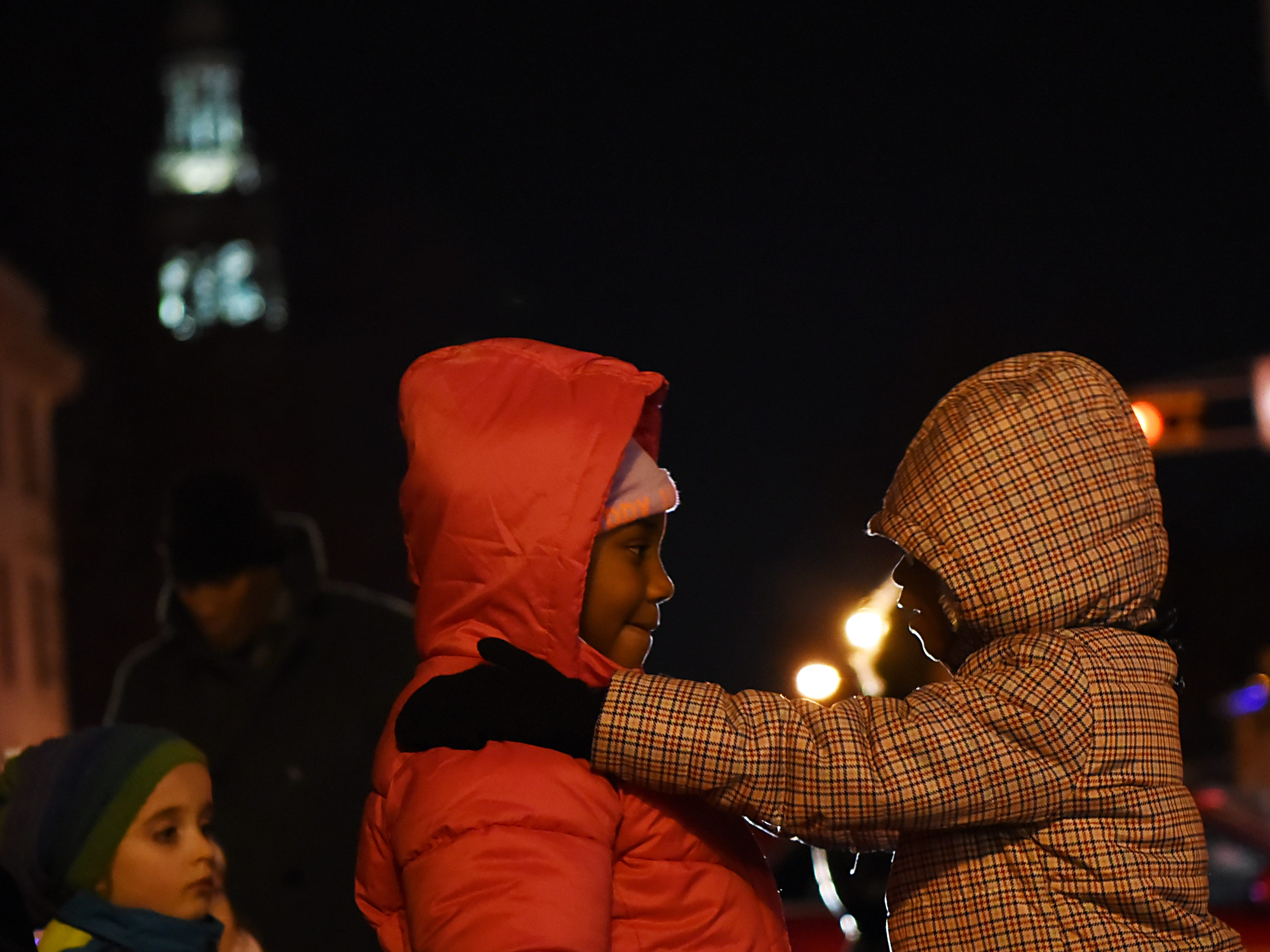 Tatiana Rhodes, 8, and Robyn Johnson, 7, attend the Montclair tree lighting in Montclair  on Friday December 7, 2018.