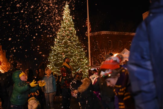Children play in the 'snow' during the Montclair tree lighting in Montclair  on Friday December 7, 2018.