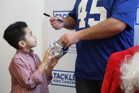 Joseph Henry 10 of Clifton has a mini Giant's helmet signed by Henry Hynoski as part of Breakfast with Santa at HackensackUMC Fitness & Wellness Powered by the Giants in Maywood on December 8, 2018.