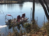 A family escaped a crash into the river. The car was pulled out of the river near Totowa Avenue in Paterson on Dec. 8.