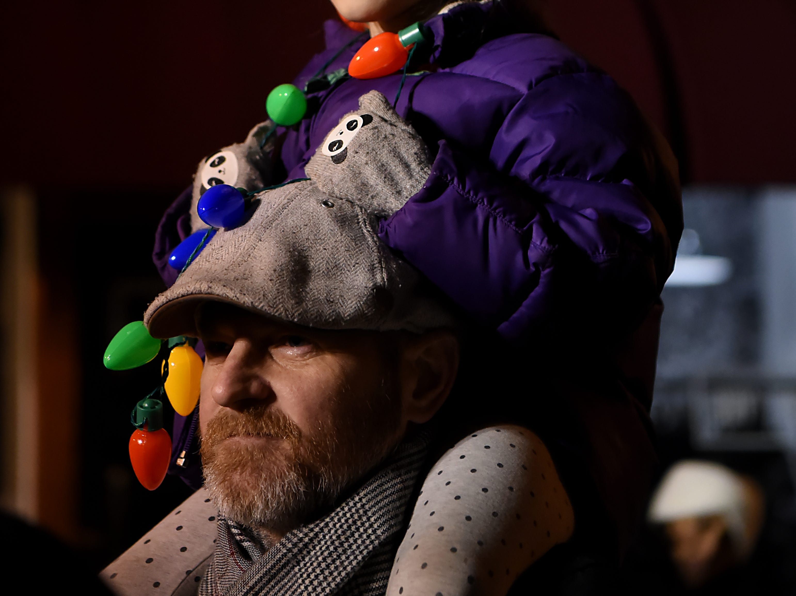 Kaija Andersen, 6, sits atop Jason Anderson's shoulders during the Montclair tree lighting in Montclair  on Friday December 7, 2018.