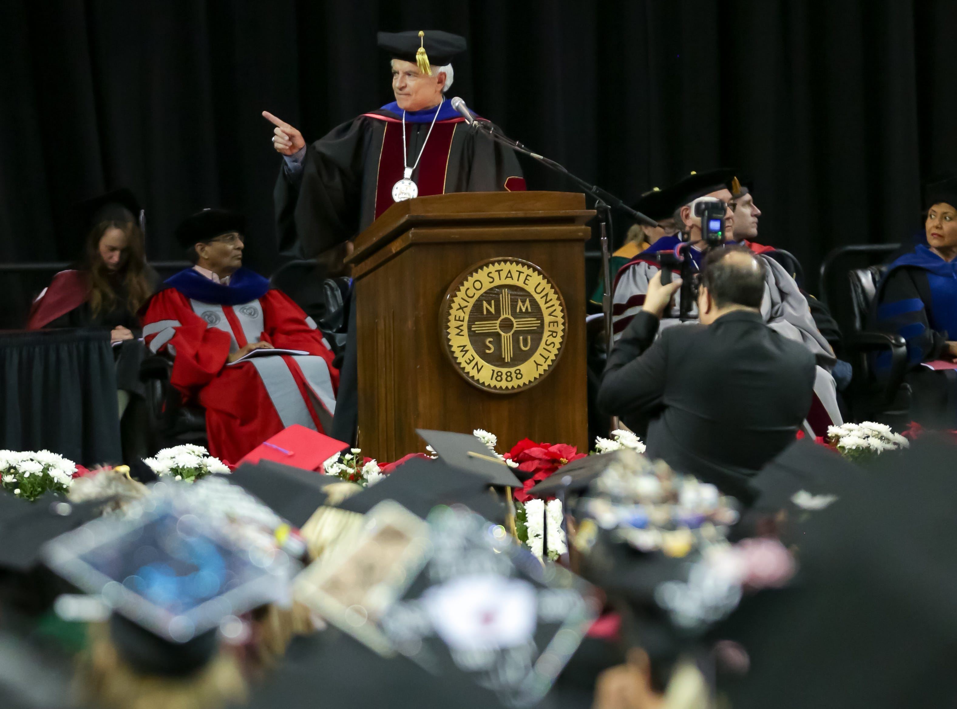 NMSU Chancellor Dan Arvizu speaks at the start of NMSU commencement ceremony on Saturday, Dec. 8, 2018 at the Pan American Center.