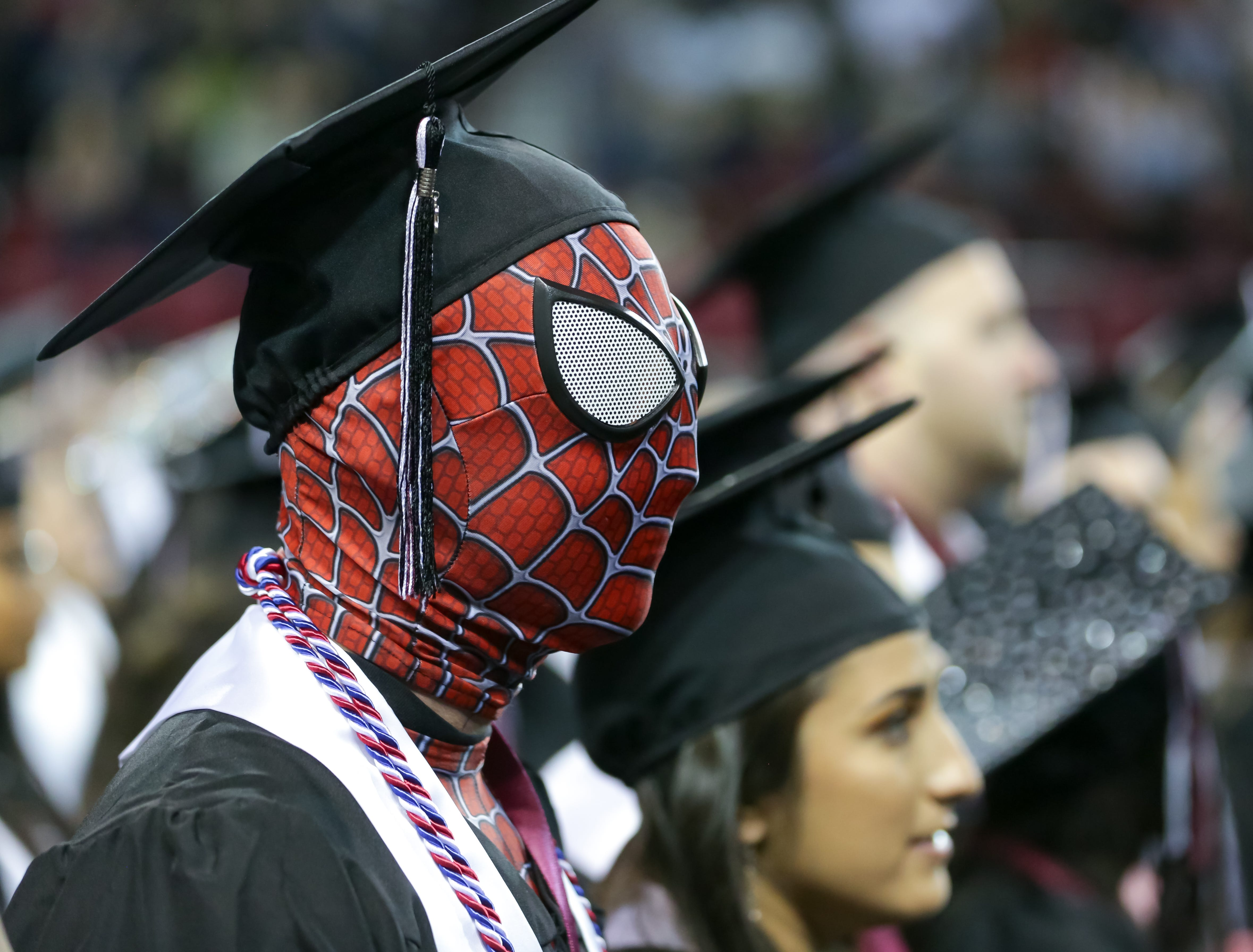 Spenser Tucker dresses as Spiderman during the NMSU commencement ceremoney on Saturday, Dec. 8, 2018 at the Pan American Center.
