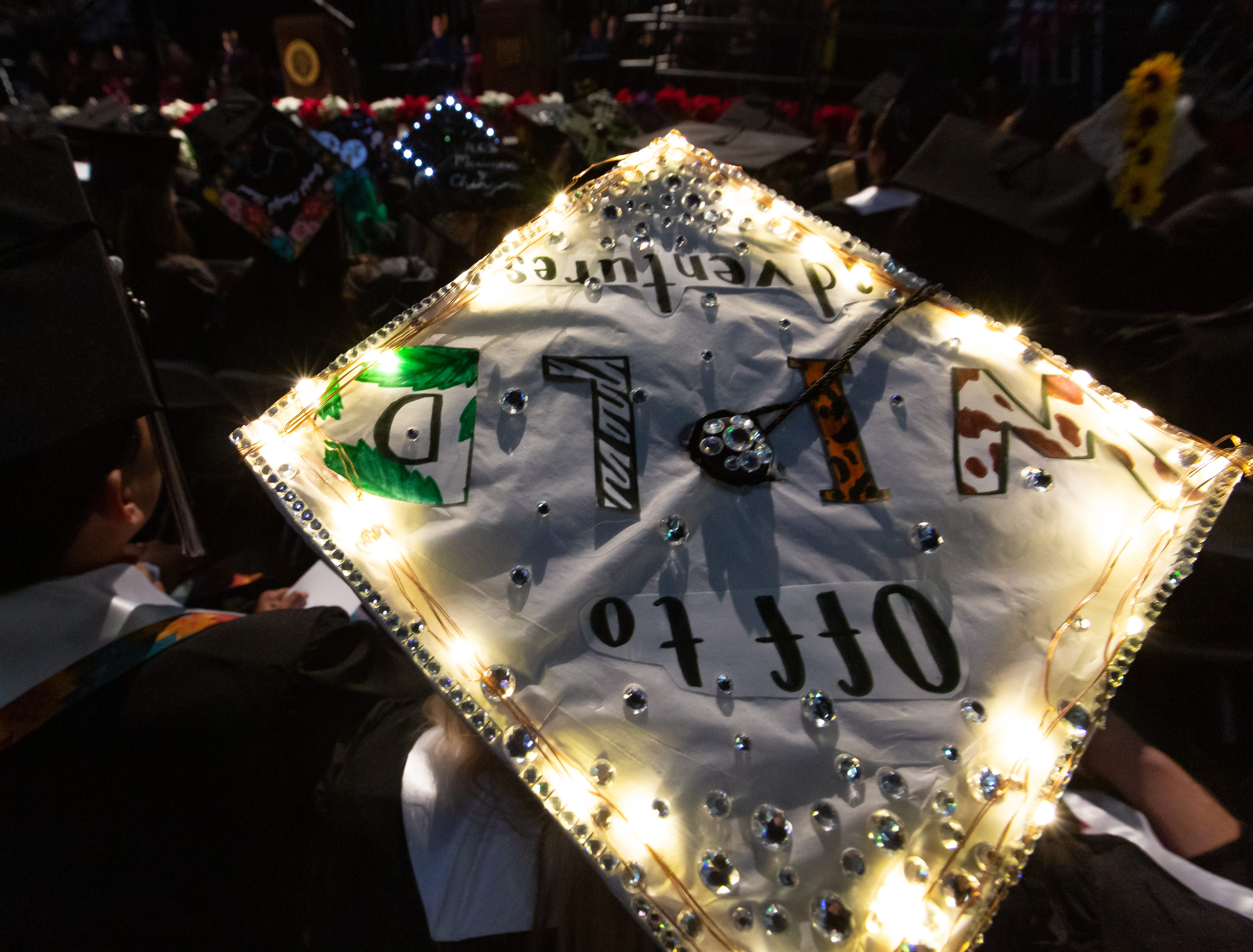 Students wear their decorated mortar boards during NMSU commencement on Saturday, Dec. 8, 2018 at the Pan American Center.