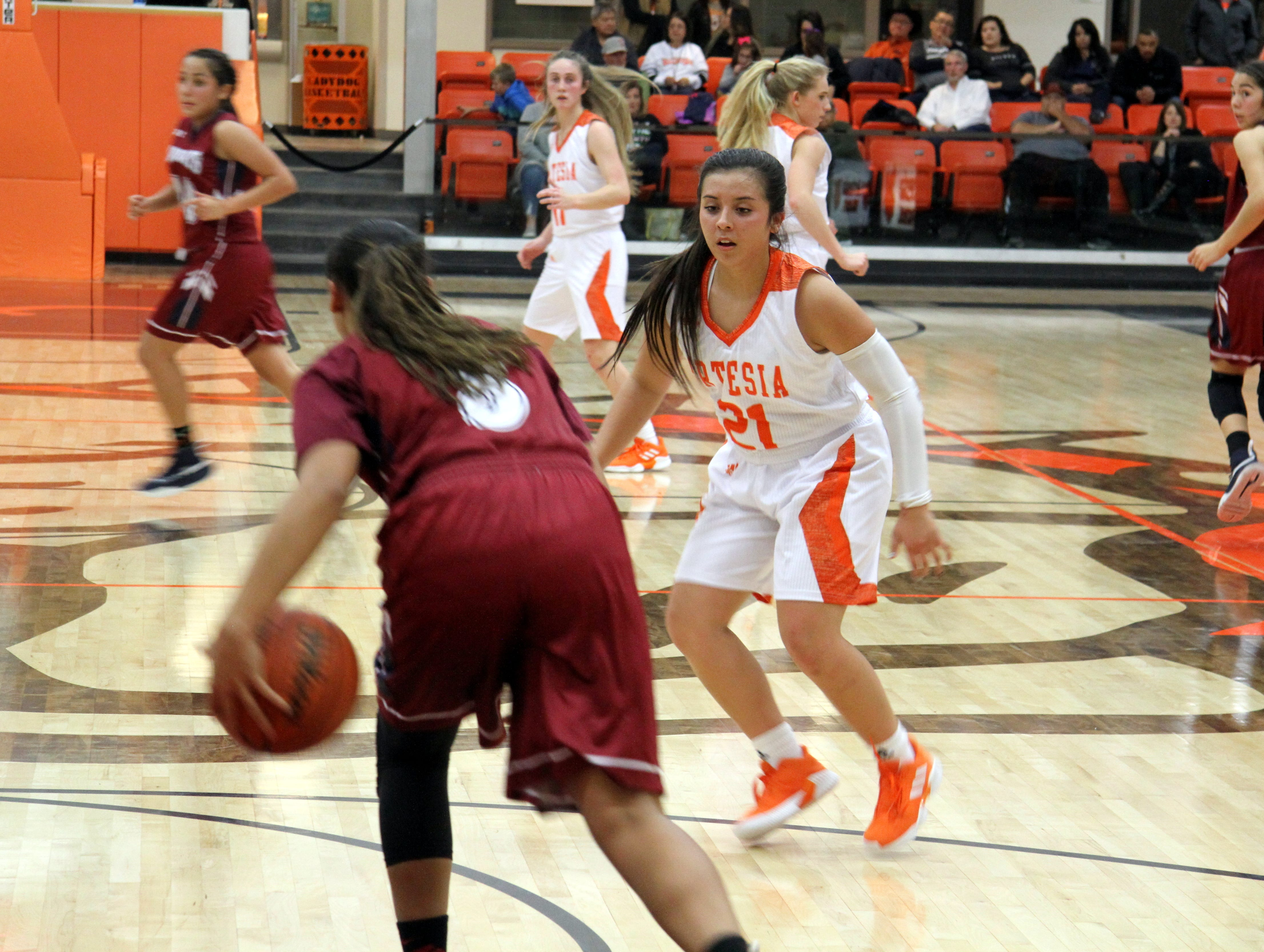 Kyrah Gonzales (21) guards a Deming player during Friday's second round of the Artesia Tournament of Champions.
