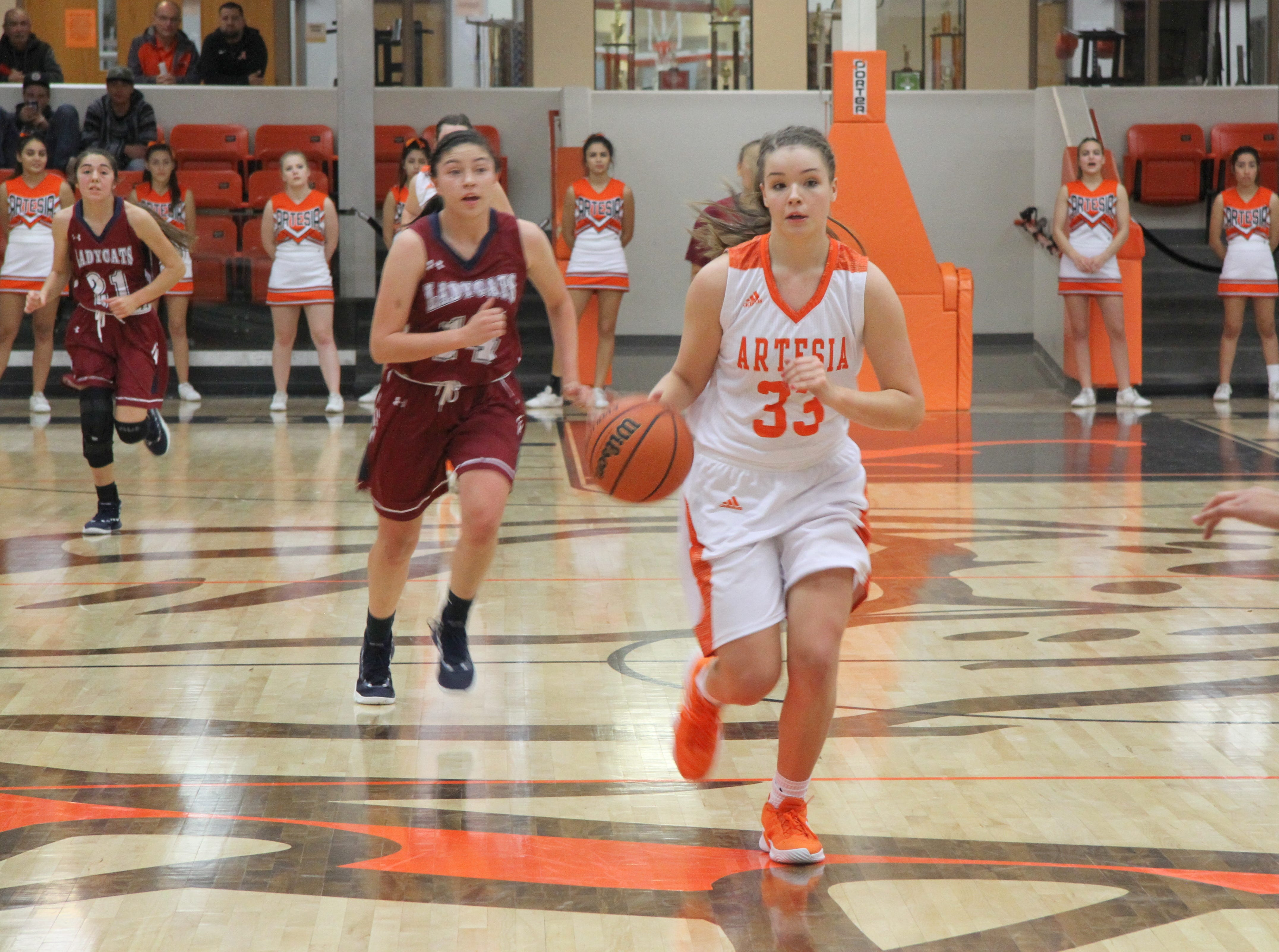 Kaylee Wagner leads a fastbreak against Deming during Friday's second round of the Artesia Tournament of Champions.