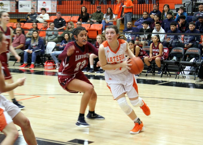 Paityn Houghtaling drives for a basket during Friday's second round of the Artesia Tournament of Champions.