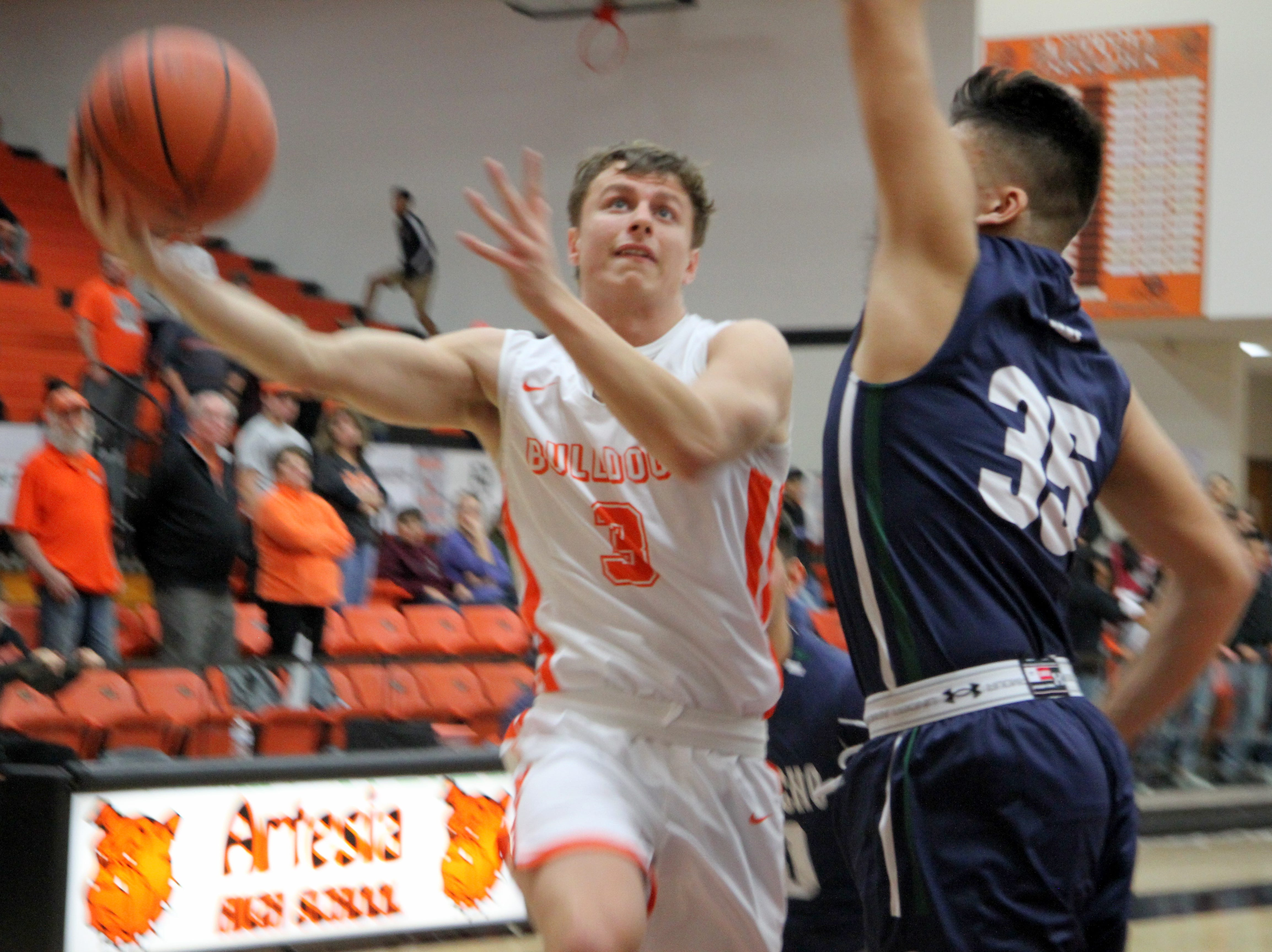 Artesia's Cody Smith goes for a contested layup during Friday's second round of the Artesia Tournament of Champions against Rio Rancho.