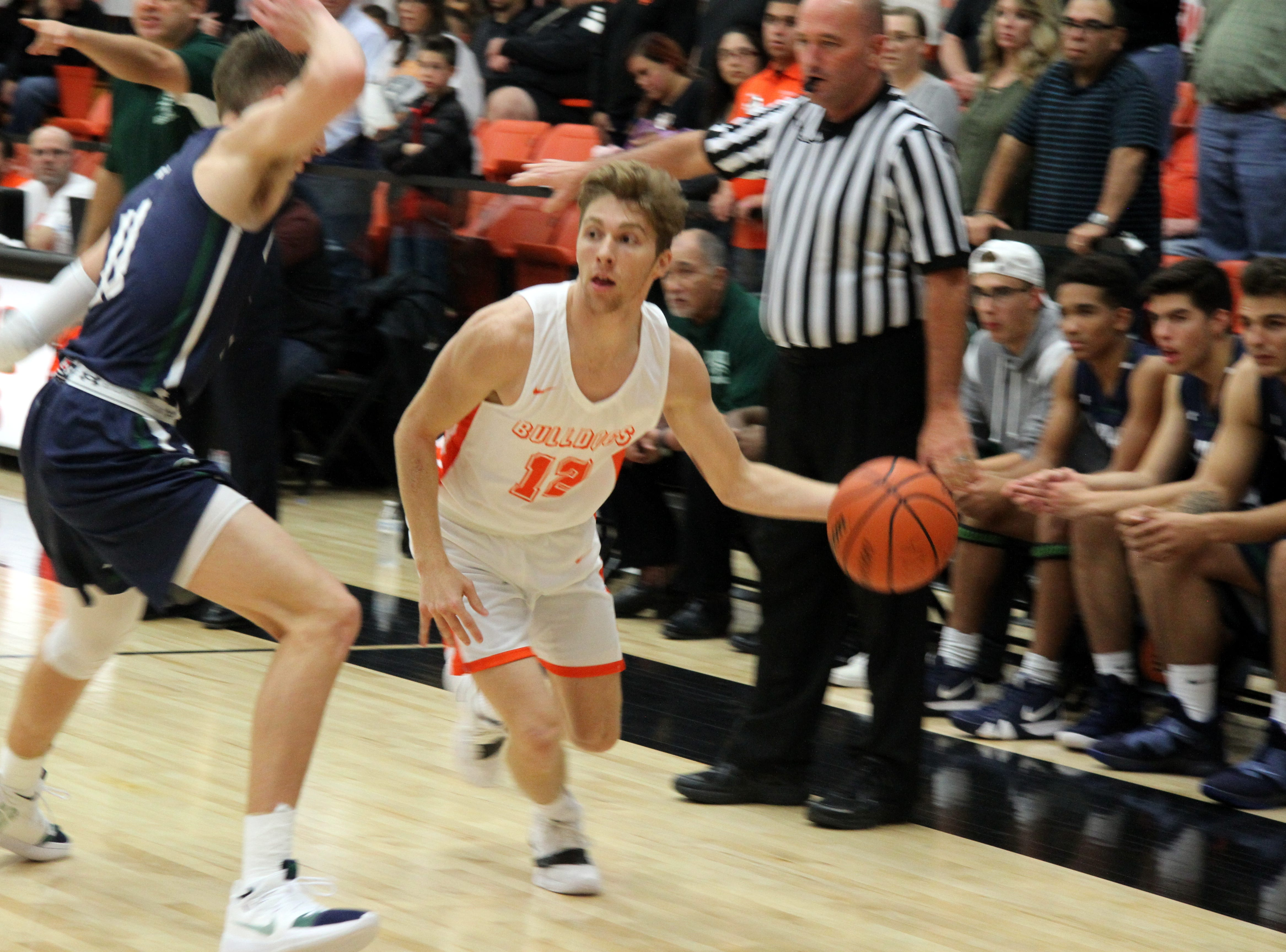 Artesia's Luke Nelson (12) drives by a Rio Rancho defender during Friday's second round of the Artesia Tournament of Champions.