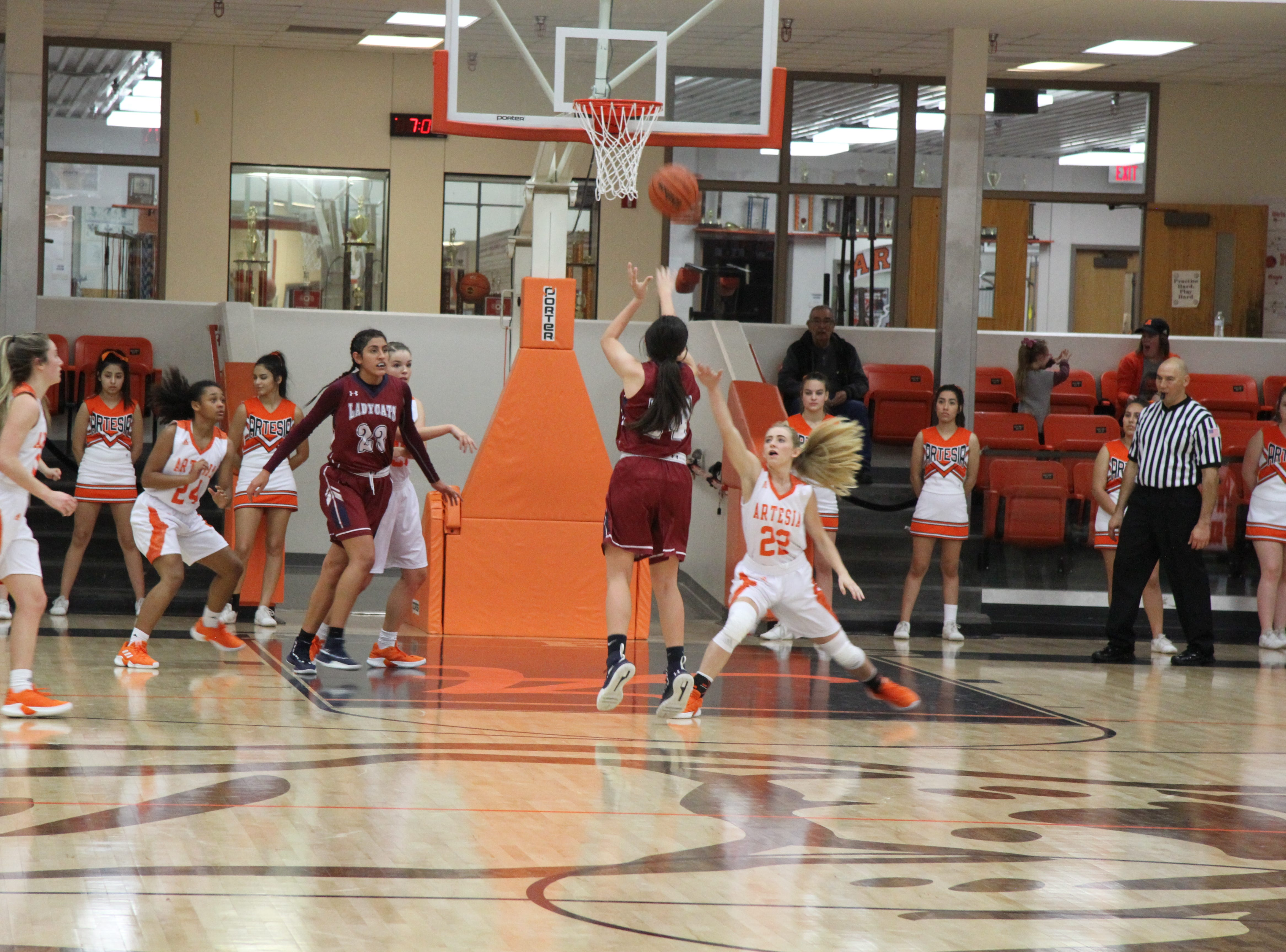 Artesia's Faith Evans (22) tries to block a Deming shot during Friday's second round of the Artesia Tournament of Champions.