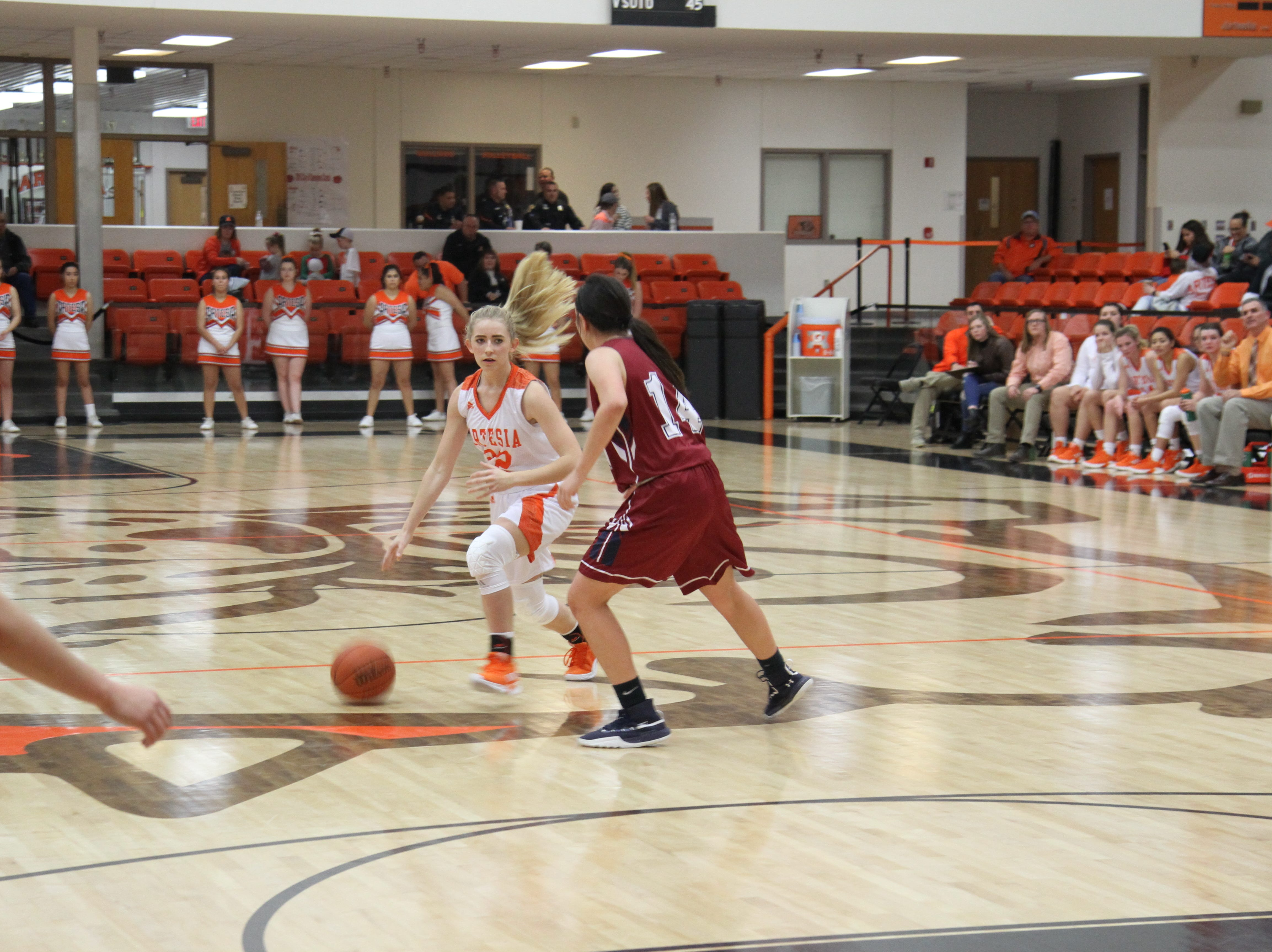 Faith Evans tries to dribble by a Deming defender during Friday's second round of the Artesia Tournament of Champions.