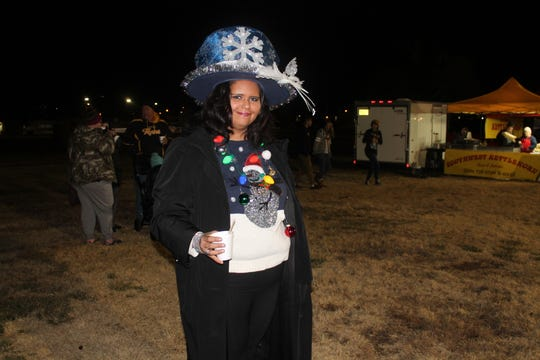 Sasha Saunders attended the tree-lighting event bedecked in her holiday finery.