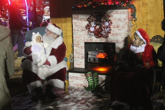 Children of all ages were able to sit on Santa's lap at the Alamogordo tree-lighting event on Friday evening.