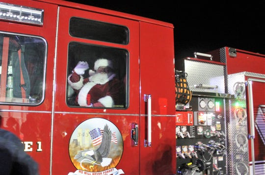 Much to the children's delight, Santa arrived at the Alamogordo tree lighting in a fire truck.