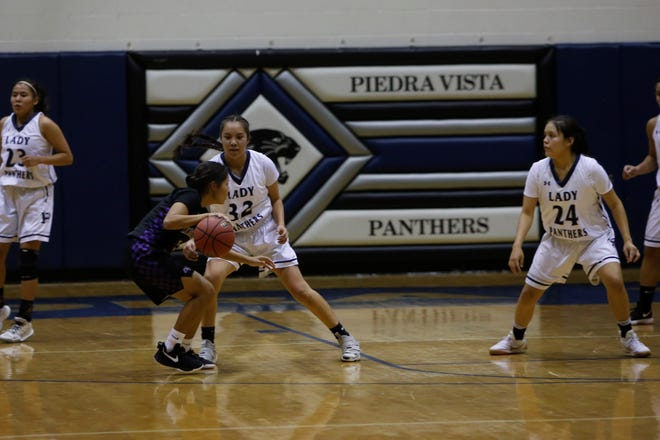 Piedra Vista's Lanae Billy (32) locks down the wing as teammate Tai Tai Woods (24) watches nearby during last Tuesday's home opener against Kirtland Central at Jerry A. Conner Fieldhouse in Farmington. Billy and Woods are making immediate impacts after transferring from Shiprock High School.
