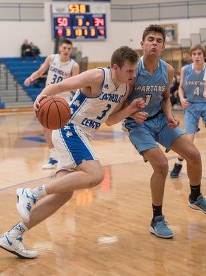 Davis Lukomski (3) drives to the basket. Spartan Chris Mars (1) blocks the path.