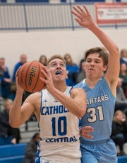 Mike Harding (10) drives to the basket with Ethan Young (31) right behind him.
