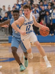 CC Keegan Koehler (12) drives in from center court with Stevenson's Evan Asante (5) on his tail.