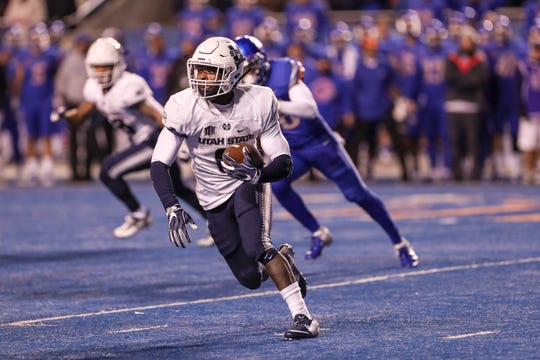 BOISE, ID - NOVEMBER 24: Running back Gerold Bright #8 of the Utah State Aggies catches a screen pass for a late fourth quarter touchdown during second half action against the Boise State Broncos on November 24, 2018 at Albertsons Stadium in Boise, Idaho. Boise State won the game 33-24. (Photo by Loren Orr/Getty Images)