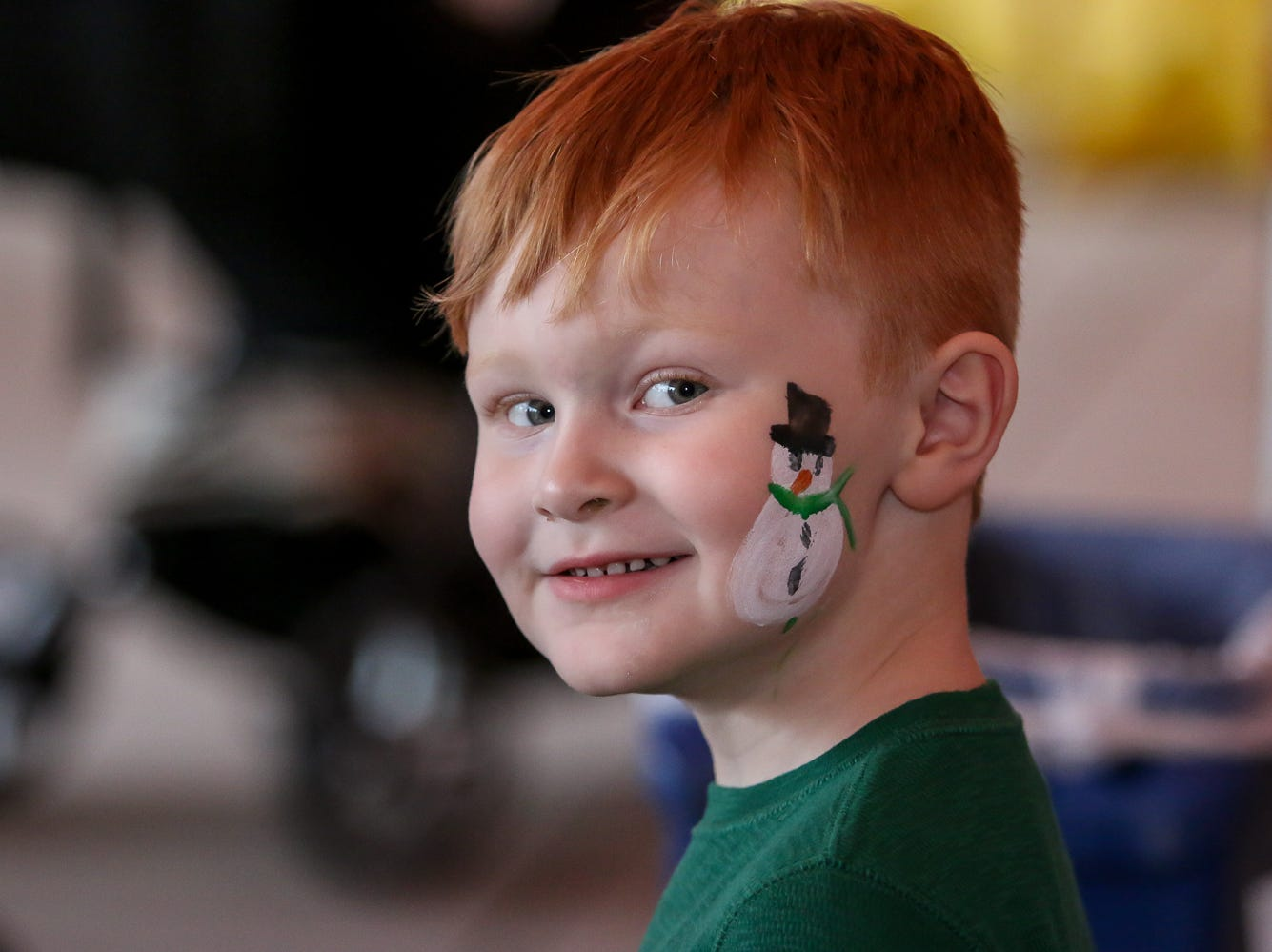 Ryan Johnston, 4, smiles after having his face painted during the Santa Drop at the Flora-Bama Lounge, Package and Oyster Bar on Saturday, December 8, 2018. Usually Santa arrives by parachuting in, however, was unable to do to due to the weather.