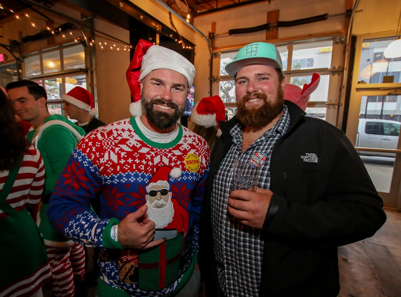 Kaboom Sports and Social Club kicks off its sixth annual Ugly Sweater Pub Crawl at Perfect Plain Brewing Co. on Saturday, Dec. 8, 2018.