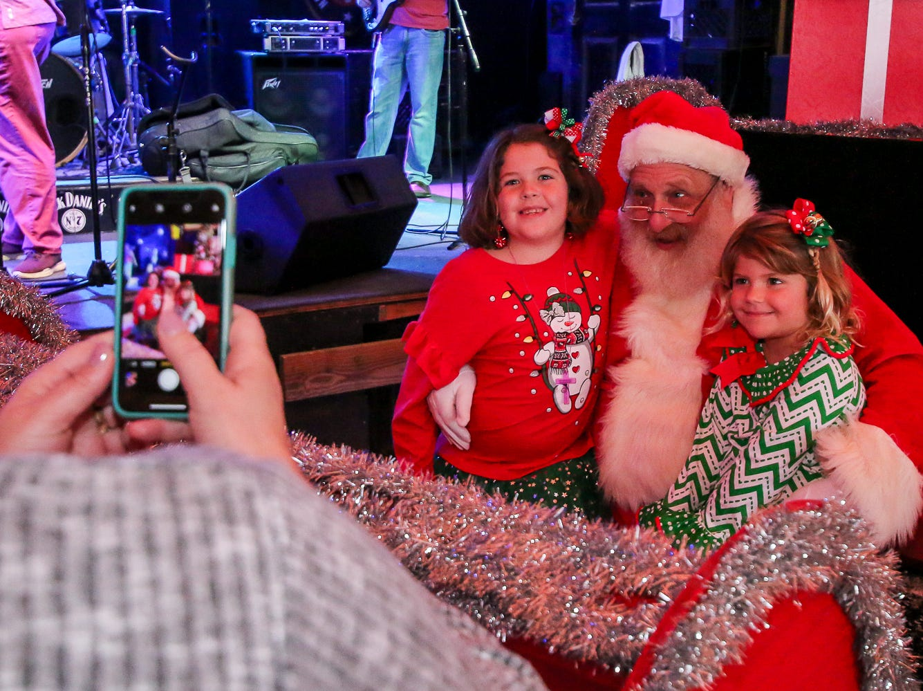 People have their picture taken with Santa during the Santa Drop at the Flora-Bama Lounge, Package and Oyster Bar on Saturday, December 8, 2018. Usually Santa arrives by parachuting in, however, was unable to do to due to the weather.