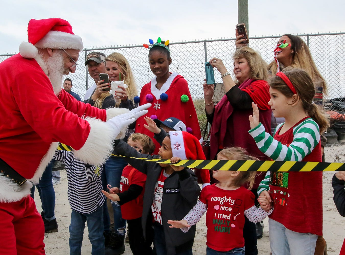 People welcome Santa to the Flora-Bama Lounge, Package and Oyster Bar on Saturday, December 8, 2018. Usually Santa arrives by parachuting in, however, was unable to do to due to the weather.