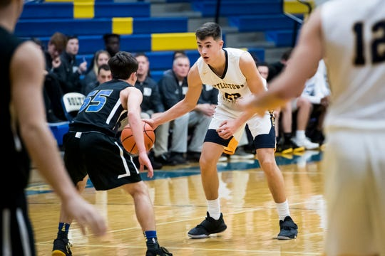 Littlestown's Logan Collins dribbles the ball in front of Kennard-Dale's Carter Day during the Southern Border Shootout boys' basketball tournament at Littlestown High School on Dec. 7, 2018. Both players were the top scorers for their teams; Collins finished with 35 points and Day scored 28.