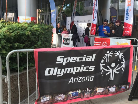 Several wait to rappel off of a 27 story Phoenix skyrise in support of Special Olympics Arizona.